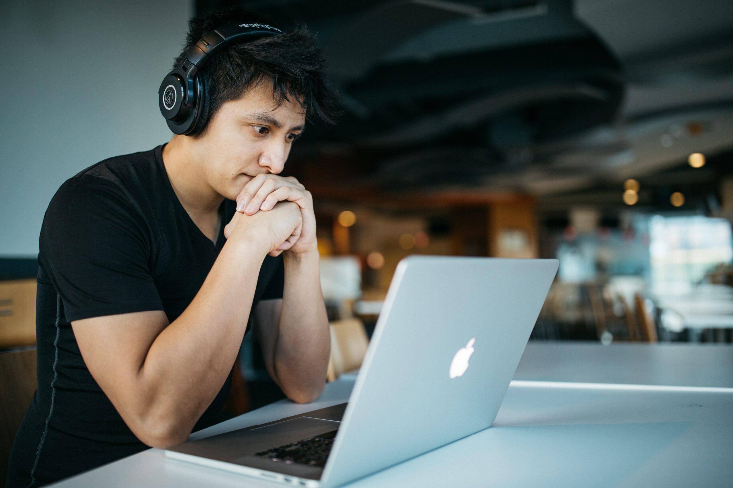 Man at computer.