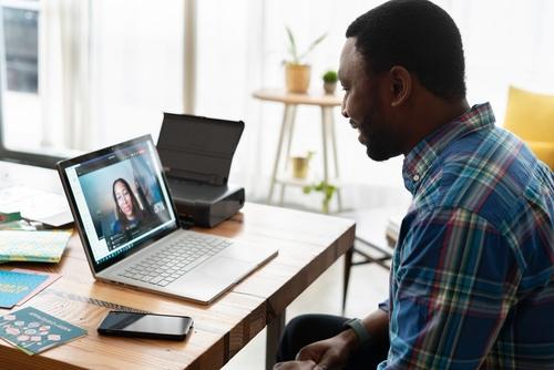 man video chatting at work.